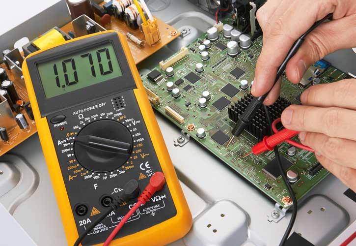 Multimeter testing PCB