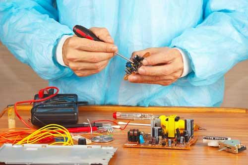 Technician Fixing Circuit Board